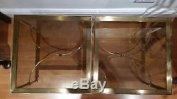 A set of vintage brass and smoked glass coffee tables